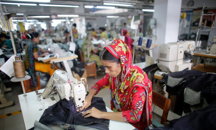 A worker works in a garment factory in Savar June 10, 2014. (Andrew Biraj/File Photo/Reuters)