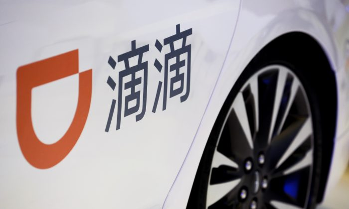 The company logo of the Didi ride hailing app is seen on a car door at the IEEV New Energy Vehicles Exhibition in Beijing on Oct. 18, 2018. (Thomas Peter/Reuters)