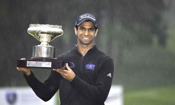 Aaron Rai of England displays the Hong Kong Open trophy after winning a wire-to-wire victory, his first European Tour win, just holding off Matthew Fitzpatrick also of England by a single stroke at Fanling Golf Club on Sunday Nov 25. (Bill Cox).
