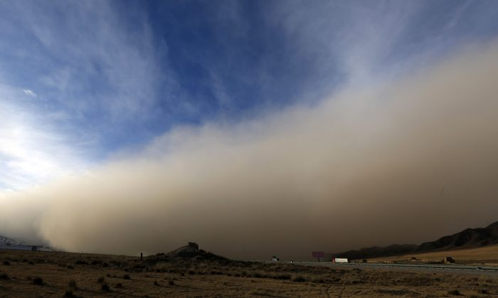 This photo taken on November 25, 2018 shows a sandstorm rolling into Zhangye in China's northwestern Gansu province. A northwest Chinese city was engulfed by a massive sandstorm that sparked rural fires, forced traffic to slow down and prompted residents to cover their faces, according to state media. (AFP/Getty Images)