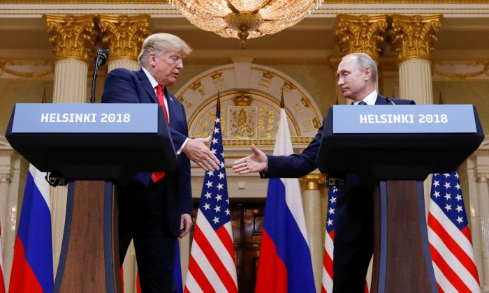 President Donald Trump and Russia's President Vladimir Putin shake hands during a joint news conference after their meeting in Helsinki, Finland, on July 16, 2018. (Kevin Lamarque/Reuters)
