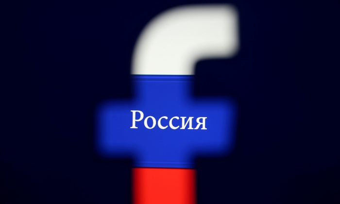 A 3D printed Facebook logo is seen in front of a displayed Russian flag in this photo illustration taken on August 3, 2018. Photo illustration taken on Aug. 3, 2018. (Dado Ruvic/Reuters)