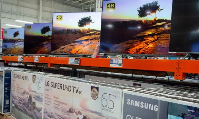 Samsung high definition televisions are seen for sale at a Costco store in Washington, DC, September 27, 2018. - A universe of Chinese-made goods found in every American home is now subject to the sprawling tariffs imposed by President Donald Trump, with the brunt of costs to be borne by US consumers, key drivers of the American economy. (Photo by SAUL LOEB / AFP)        (Photo credit should read SAUL LOEB/AFP/Getty Images)