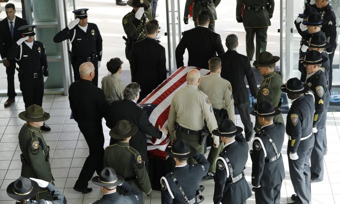 The casket with the body of Ventura County Sheriff Sgt. Ron Helus is carried out after a memorial service at Calvary Community Church in Westlake Village, Calif., on Nov. 15, 2018. (Al Seib / Los Angeles Times)