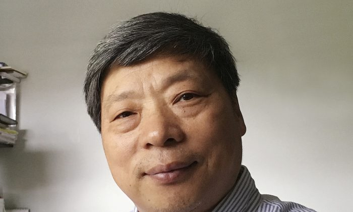 Lu Guang poses for a photo in New York on July 2018. The wife of award-winning Chinese photographer Lu says he was taken away by state security agents more than three weeks ago during a trip to China's far western region. Lu's wife, Xu, says he was traveling in Xinjiang when she lost contact with him. (Xu Xiaoli via AP)