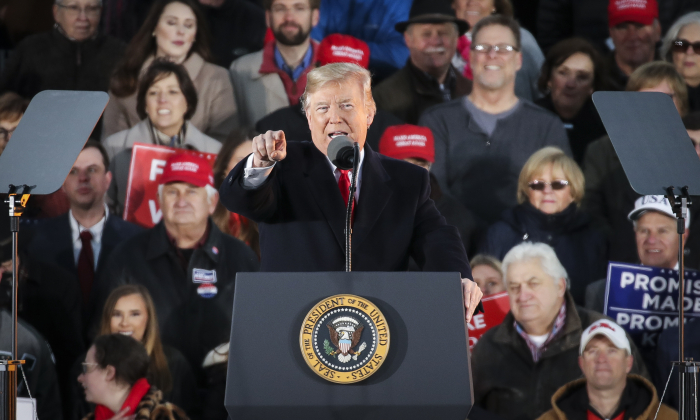 President Donald Trump speaks during a rally at the Tupelo Regional Airport in Tupelo, Mississippi, on Nov. 26, 2018. (Drew Angerer/Getty Images)