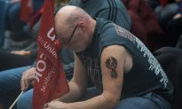 Emotional General Motors Workers Seen Wiping Away Tears After Company Lays Off 14,500 People