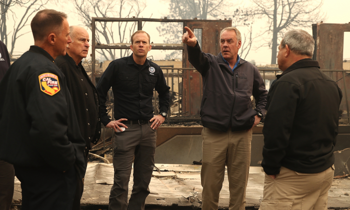 California Governor Jerry Brown and FEMA Adminstrator Brock Long and U.S. Secretary of the Interior Ryan Zinke tour a school burned by the Camp Fire on November 14, 2018 in Paradise, California. Fueled by high winds and low humidity, the Camp Fire ripped through the town of Paradise charring over 135,000 acres, killing at least 48 people and destroying over 8,000 homes and businesses. The fire is currently at 35 percent containment.  (Photo by Justin Sullivan/Getty Images)