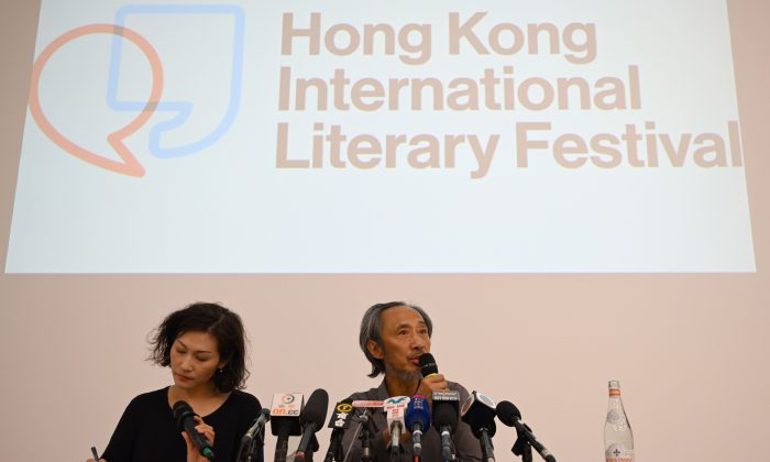 Dissident Chinese author Ma Jian (R) speaks during a press conference at the new Tai Kwun arts centre in Hong Kong on Nov. 10, 2018, which hosts the Hong Kong International Literary Festival and had originally cancelled his talks under pressure from Beijing. (ANTHONY WALLACE/AFP/Getty Images)