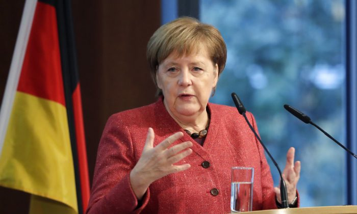 German Chancellor Angela Merkel delivers a speech during the German Ukrainian Economy Forum in Berlin, Germany, on Nov. 29, 2018. (AP Photo/Michael Sohn)