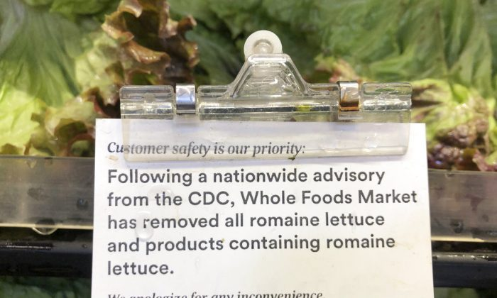 A sign is posted about romaine lettuce at a Whole Foods Market in Jenkintown, Pa., on Nov. 28, 2018. (AP Photo/Matt Rourke)