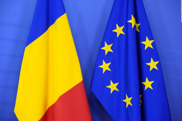 Romanian and EU flags at the European Commission headquarters in Brussels in this file photo.