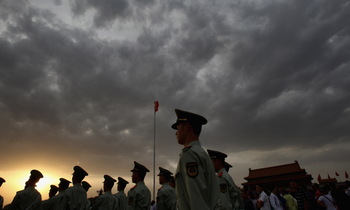 Paramilitary policemen patrol at the Tiananmen Square outside the Forbidden City, which was the Chinese imperial palace from the mid-Ming Dynasty to the end of the Qing Dynasty, in Beijing, China, in this file photo. (Feng Li/Getty Images)