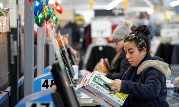 A customer makes a purchase at a Walmart store in Chicago, Illinois, on Nov. 20, 2018. (Kamil Krzaczynski/Reuters)