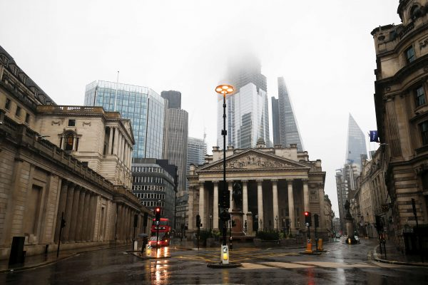 The Bank of England in London's financial district during rainy weather