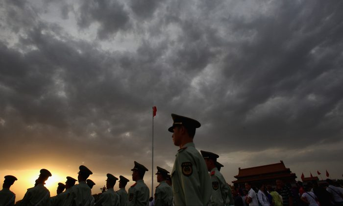 Paramilitary policemen patrol Tiananmen Square outside the Forbidden City in Beijing, on May 18, 2011. (Feng Li/Getty Images)