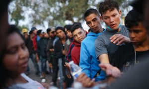 Mexico Deports 100 'Violent' Migrants After Caravan Mob Rushed Border