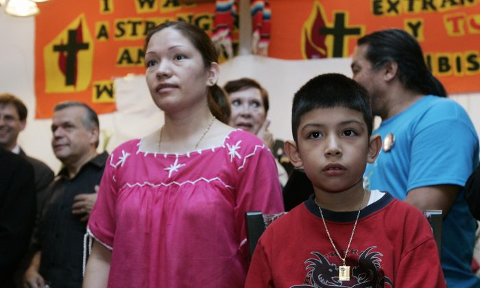 Immigrant rights activist Elvira Arellano (L) of Mexico stands with her U.S.-born son Saul at a press conference inside the Adalberto United Methodist Church on Aug. 15, 2007, in Chicago, Illinois, where she had taken refuge for a year because she faced deportation. She became the poster child for those who argue that illegal aliens with U.S.-born children should never face deportation. (JEFF HAYNES/AFP/Getty Images)