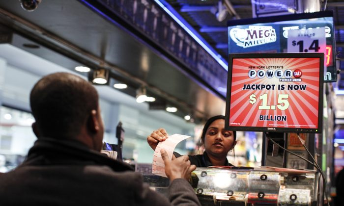 In this file photo a man buys a Powerball lottery ticket at a newsstand in New York City. Some people like state lotteries because they are run by the government; others are suspicious of them for that same reason. (KENA BETANCUR/AFP/Getty Images)