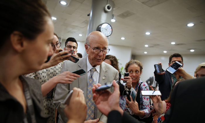 Sen. Pat Roberts (R-KS) speaks to reporters as he arrives for the weekly Senate Republican's policy luncheon, on Capitol Hill in Washington on July 24, 2018. (Al Drago/Getty Images)
