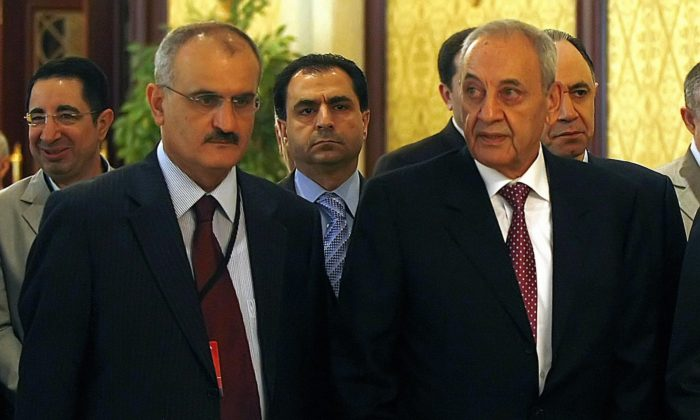 Lebanon's Parliament Speaker Nabih Berri (R) arrives with his political aide Ali Hassan Khalil (L) to attend a roundtable meeting with other Lebanese leaders in Doha on May 17, 2008. (Marwan Naamani/AFP/Getty Images)