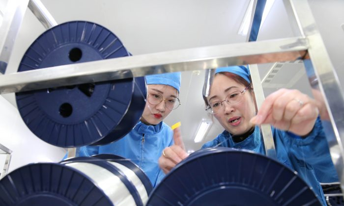 Staff work in a fibre-optic cable factory in Nantong City, Jiangsu Province, on Nov. 27, 2018. (AFP/Getty Images)