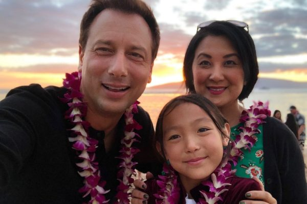 Chris Burrous is with his wife and daughter