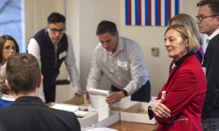Alaska House District 1 candidate Democrat Kathryn Dodge, right, watches the election recount at the Department of Elections' Juneau office on Nov. 30, 2018.(Michael Penn/The Juneau Empire via AP)