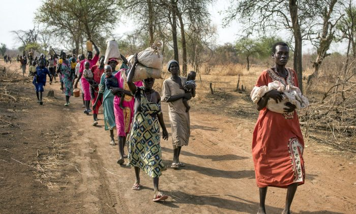 People walk for hours to reach a food distribution site in Malualkuel in the Northern Bahr el Ghazal region of South Sudan, on April 5, 2017. (AP Photo, File)