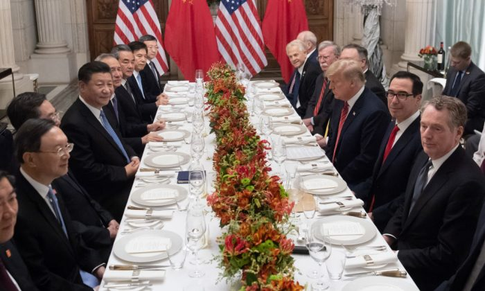 US President Donald Trump (C-R) and Chinese leader Xi Jinping (C-L) along with members of their delegations, hold a dinner meeting at the end of the G20 Leaders' Summit in Buenos Aires, on Dec. 01, 2018. (Saul Loeb/AFP/Getty Images)