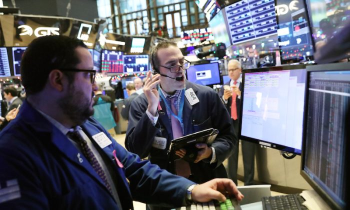 Traders work on the floor at the New York Stock Exchange (NYSE) in New York City, on Nov. 30, 2018. (Brendan McDermid/Reuters)