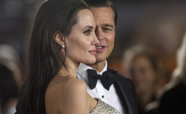 """Angelina Jolie and her husband and co-star Brad Pitt pose at the premiere of """"By the Sea"""""""