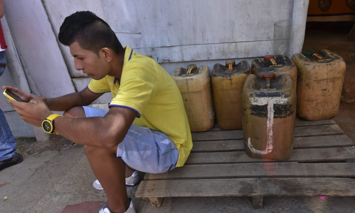 A man uses his mobile phone in Cucuta, Colombia, in this file photo.  (Luis Acosta/AFP/Getty Images)