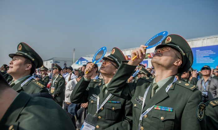 Officers of China's People Liberation Army watch an aerial display at Airshow China in Zhuhai, China, on Nov. 13, 2012.  (PHILIPPE LOPEZ/AFP/Getty Images)