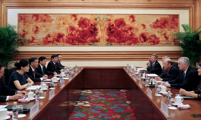 US Commerce Secretary Wilbur Ross (3rd R) and Chinese Vice Premier Wang Yang (3rd L) attend a bilateral meeting. The international world thought China central government could control all the country. But the fact maybe different. Sept. 25, 2017 in Beijing. (Andy Wong/AFP/Getty Images)