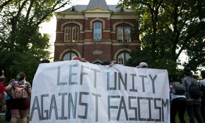 Activists demonstrate on the campus of The University of Virginia one-year after the violent white nationalist rally that left one person dead and dozens injured, in Charlottesville, Virginia on Aug. 11, 2018. (Logan Cyrus/AFP/Getty Images)
