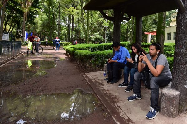 People use tablets and smartphones a public park in Mexico City in this file photo. (Alfredo Estrella/AFP/Getty Images)