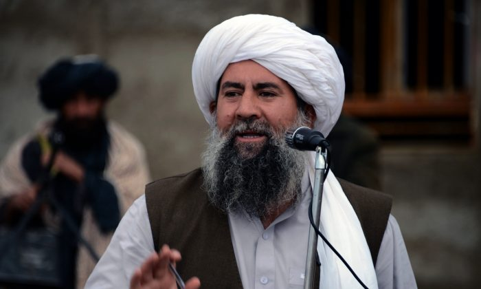 Mullah Abdul Manan Neyazi, a deputy of Mullah Mohammad Rasool Akhund, the newly appointed leader of a breakaway faction of the Taliban, addresses a gathering of supporters at Bakwah in the western province of Farah on Nov. 3, 2015. (Javed Tanveer/AFP/Getty Images)