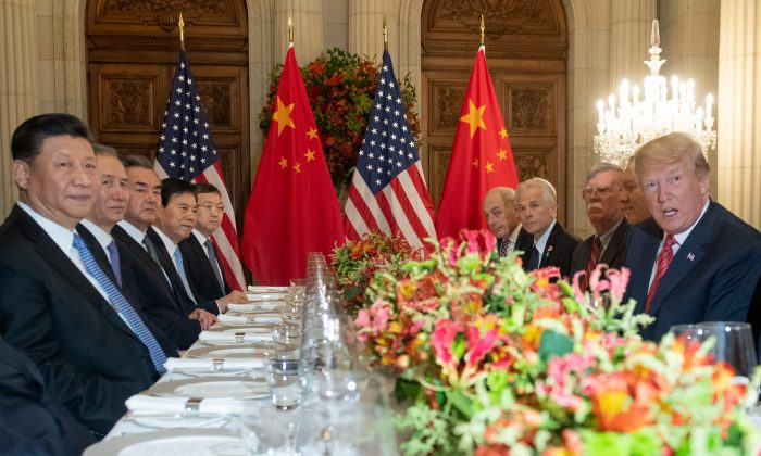 U.S. President Donald Trump (R) and China's President Xi Jinping (L) along with members of their delegations, hold a dinner meeting at the end of the G20 Leaders' Summit in Buenos Aires, on Dec. 1, 2018. (SAUL LOEB/AFP/Getty Images)