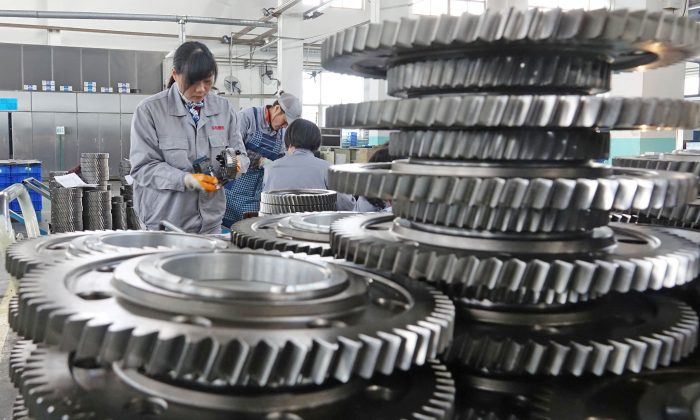 Workers inspect engine gears at a company under Dongbei Special Steel Group in Yantai, Shandong Province, China on Nov. 29, 2018. (Reuters)