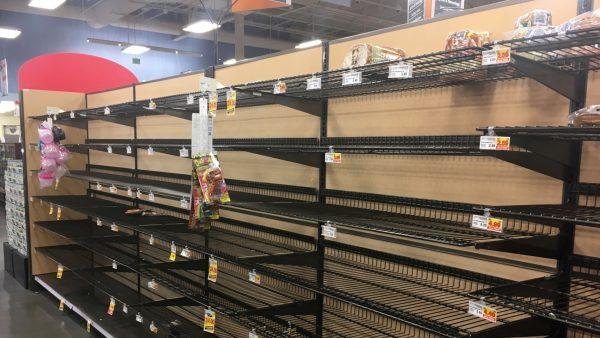 Empty shelves where bread is