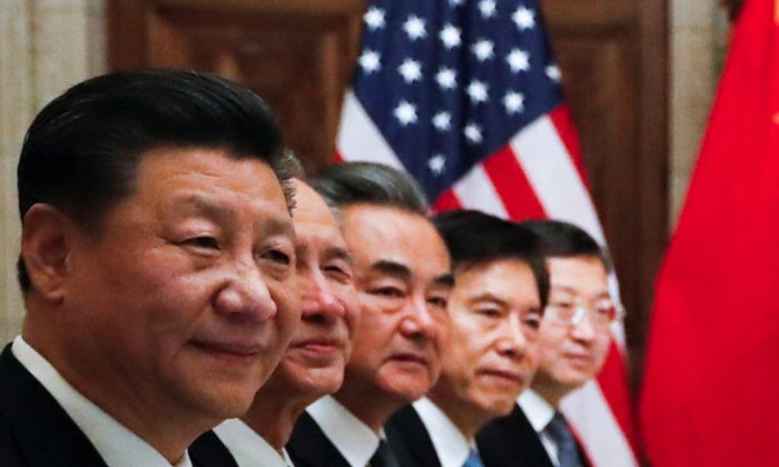 Chinese leader Xi Jinping and members of the Chinese delegation attend a working dinner with U.S. President Donald Trump after the G20 leaders summit in Buenos Aires, Argentina on Dec. 1, 2018. (Kevin Lamarque/Reuters)