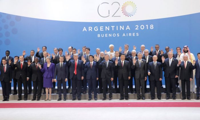 World leaders pose for the family picture during the opening day of Argentina G-20 Leaders' Summit 2018 at Costa Salguero in Buenos Aires, Argentina, on Nov. 30, 2018. (Daniel Jayo/Getty Images)