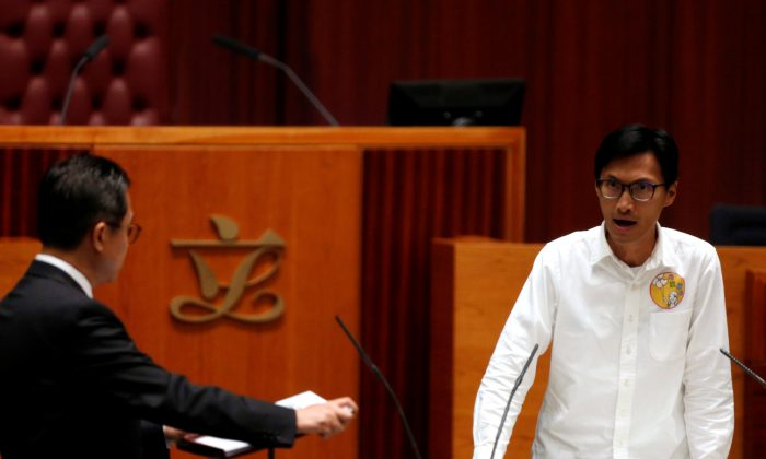 Newly elected lawmaker Eddie Chu shouts slogans while taking oath at the Legislative Council in Hong Kong on Oct. 12, 2016. (Bobby Yip/Reuters)