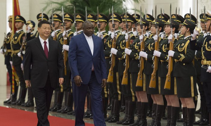 Gambia's President Adama Barrow (C) walks with Chinese leader Xi Jinping (L) during a welcoming ceremony at the Great Hall of the People in Beijing on December 21, 2017. The two countries re-established diplomatic relations in 2016. (Nicolas Asfouri/AFP/Getty Images)