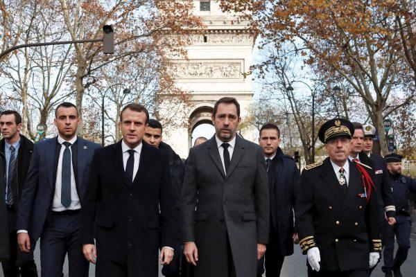 France's President Emmanuel Macron, Interior Minister Christophe Castaner, and Paris police Prefect Michel Delpuech