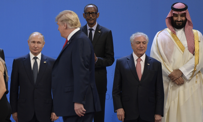 (L to R) Russia's President Vladimir Putin, US President Donald Trump, Rwandas President Paul Kagame, Brazil's President Michel Temer and Saudi Arabia's Crown Prince Mohammed bin Salman line up for a family photo, during the G-20 Leaders' Summit in Buenos Aires, on Nov. 30, 2018. (Juan Mabromate/AFP/Getty Images)