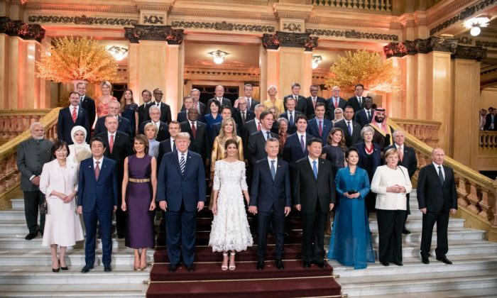 World leaders in a group photo at the Colon Theatre during the G-20 Summit in Buenos Aires, Argentina, on Nov. 30, 2018. U.S. President Donald Trump is pictured in the front row (4th L) with Chinese leader Xi Jinping (4th R). (Guido Bergmann/Bundesregierung via Getty Images)