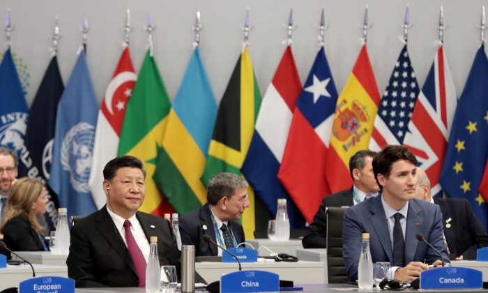 China's President Xi Jinping and Canadian Prime Minister Justin Trudeau attend the G-20 Leaders' Summit in Buenos Aires, Argentina, on Nov. 30, 2018. (Alejandro Pagni/AFP/Getty Images)