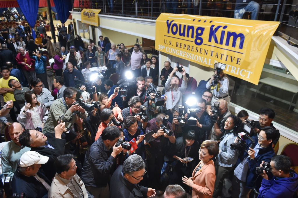 Young Kim (R) is surrounded by supporters